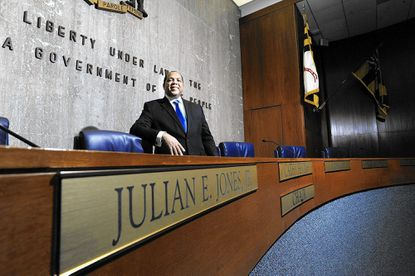 Newly elected Baltimore County 4rd District Councilman Julian Jones stands in the council chambers in Towson.