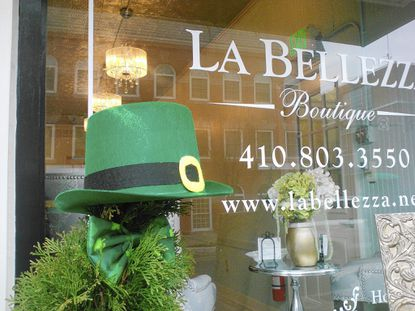 An Irish hat decorates shrubbery outside a store on Bel Air's Main Street.