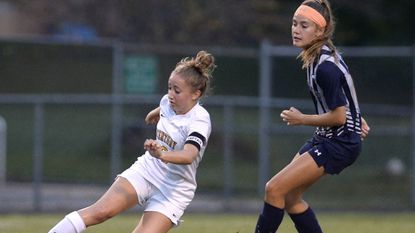 Century's Emily Rusk cuts on the ball while pursued by Manchester Valley's Jeri Garland during the first half of their game in Eldersburg Monday, Sept. 25, 2017.