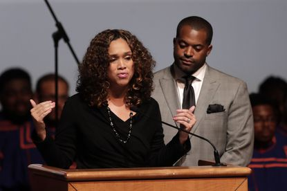 In this Wednesday, Oct. 23, 2019 file photo, Baltimore City State's Attorney Marilyn Mosby, left, speaks while standing next to her husband Nick Mosby during a viewing service for the late U.S. Rep. Elijah Cummings at Morgan State University in Baltimore. (AP Photo/Julio Cortez, File)