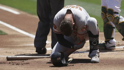 The Orioles' Trey Mancini reacts after being hit by a pitch against the Oakland Athletics during the first inning in Oakland, Calif., Wednesday, June 19, 2019. Mancini left the game after this play.