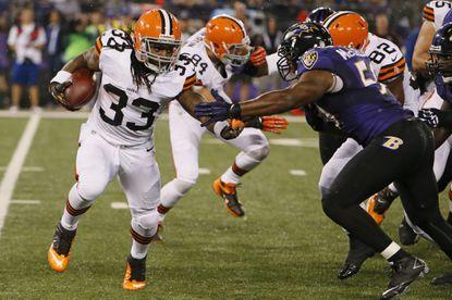 Cleveland Browns running back Trent Richardson runs past Ravens linebacker Albert McClellan (50) at M&T Bank Stadium in 2012.
