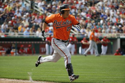 Baltimore Orioles' Hyun Soo Kim, of South Korea, runs toward first base during a spring training baseball game against the Minnesota Twins in Fort Myers, Fla., Saturday, March 5, 2016. (AP Photo/Patrick Semansky)