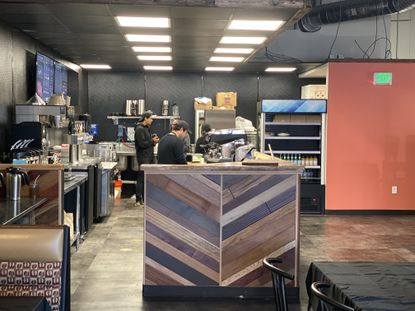 Employees work behind the coffee bar at OCA Mocha, a new community space and coffee shop in Arbutus in a site leased from the University of Maryland, Baltimore County.