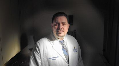 Baltimore, Md--11/3/16--Dr. Joseph Sakran, Johns Hopkins Medicine, was the victim of gun violence while in high school. Sakran was shot in the throat and that experience led him to become a trauma surgeon. He is also working to curb gun deaths. Kim Hairston/Baltimore Sun. 26881.