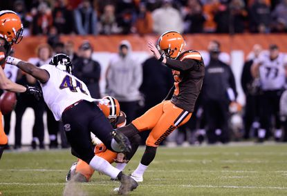 Cleveland Browns kicker Travis Coons has his field-goal attempt blocked during the fourth quarter.