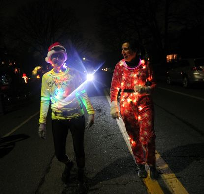 At last year's run, Michelle Macurak, right, and Dawn Carroll, both of Arbutus, wrapped themselves in Christmas lights while making their way through Catonsville during the Holiday Lights Run.