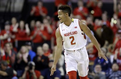 Maryland guard Melo Trimble reacts after scoring a 3-pointer in the first half against Michigan State.