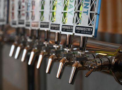 Tap handles at the Ministry of Brewing in Upper Fells Point mimic stained glass windows.