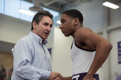 MSJ Clement Woods shakes hands with coach Harry Barnabae after defeating St. Mary's Ryken Blake Jury. Mount Mat Madness wrestling tournament at Mount Saint Joseph High School on Saturday, December 29.