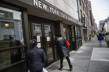 Visitors are unable to gain access to the Department of Labor due to closures over coronavirus concerns, Wednesday, March 18, 2020, in New York. Applications for jobless benefits increased by a record 3.3 million last week, according to the most recent U.S. Labor Department report.