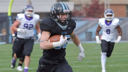 Johns Hopkins' Ryan Cary (35) runs for a 62-yard touchdown against Mount Union in the second round of the NCAA DIvision III playoffs last season.