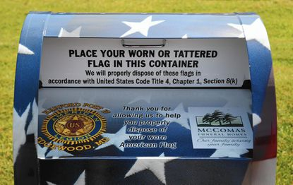 A box to properly dispose of worn or tattered American flags at the Patrick Dailey-Mark Logsdon Memorial Service Post 17 on Edgewood Road was vandalized over the weekend.