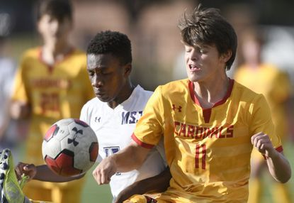 Mount Saint Joseph and Ty Stroud, left, battled for a ball with Calvert Hall's Liam Giblin during the Gaels' 3-0 victory. Mount Saint Joseph took over the top spot in The Baltimore Sun's boys soccer rankings.