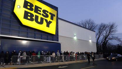 This is a view of the long line outside the Best Buy just before the store's opening.