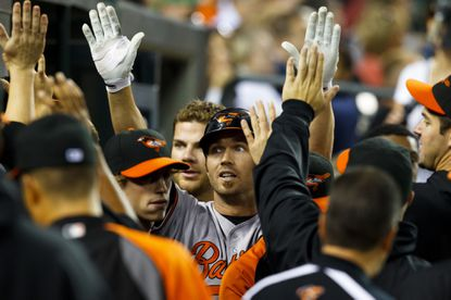 J.J. Hardy receives congratulations from teammates after hitting a home run in the third inning.
