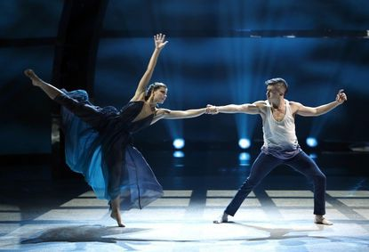 """Top 20 contestants Carly Blaney (left) and Rudy Abreu perform a Contemporary routine on """"So You Think You Can Dance."""""""
