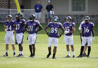 Steve Smith Sr. (89) stands next to his fellow Ravens wide receivers during training camp Thursday.