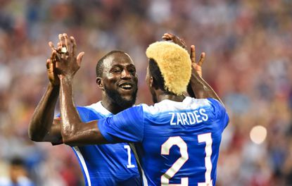 Jozy Altidore (L) of the US celebrates with teammate Gyasi Zardes after scoring his second goal against Peru during an international friendly football match at RFK Stadium in Washington on Sept. 4, 2015.