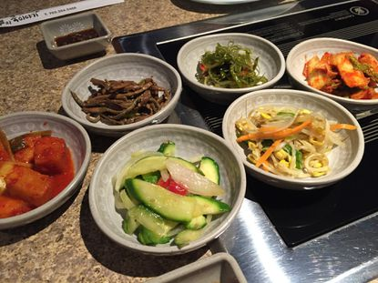 Banchan, an assortment of shareable appetizers, at Blue Sand Seafood, a new Korean restaurant in Ellicott City.