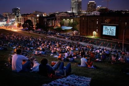 "The American Visionary Art Museum's ""Flicks From The Hill,"" a free outdoor movie series, will begin its 2015 season July 9 with a screening of ""Jaws."""