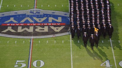 Company 5 marches near the 50-yard line during the march-on of Midshipmen before the start of the 2016 Army Navy football game at M&T Bank Stadium.