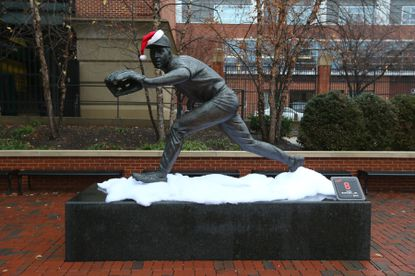 A statue of Cal Ripken Jr. is decorated for a snowy Christmas at Orioles Winter Warm-Up.
