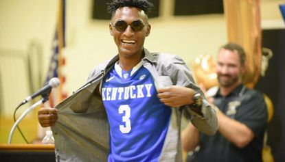 John Carroll basketball standout Immanuel Quickley reveals a Kentucky jersey under his shirt as he announces his commitment to play basketball at the University of Kentucky during a press conference at John Carroll School in Bel Air on Friday, Sept. 22.