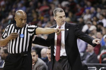 Maryland coach Mark Turgeon, right, speaks with an official during the first half of a first-round game against South Dakota State in the NCAA tournament in Spokane, Wash., Friday, March 18, 2016.