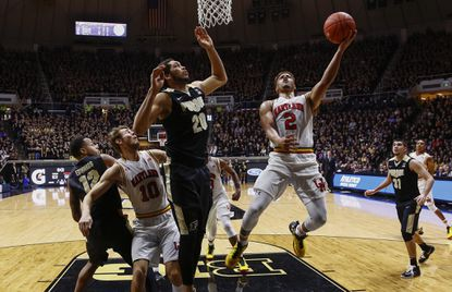 Melo Trimble of the Maryland Terps, right, shoots the ball against A.J. Hammons of the Purdue Boilermakers at Mackey Arena on Feb. 27, 2016 in West Lafayette, Ind.