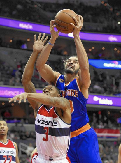 New York Knicks center Joakim Noah, top, battles for the ball against Washington Wizards guard Bradley Beal (3) during the first half of an NBA basketball game, Tuesday, Jan. 31, 2017, in Washington. (AP Photo/Nick Wass)