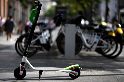This file photo shows an electric scooter of the Lime electric scooter-sharing service in Madrid on September 5, 2018.