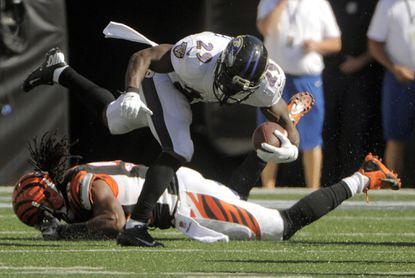 Ravens running back Justin Forsett is stopped by Bengals linebacker Emmanuel Lamur after a short reception in the fourth quarter.
