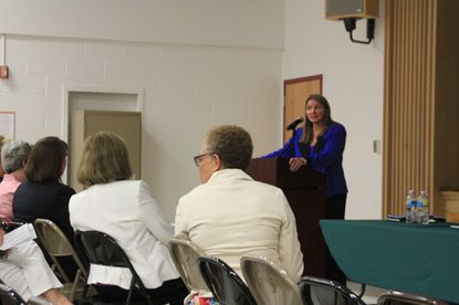 Howard County Public School System Superintendent Renee Foose addresses parents Aug. 19 at a community informational meeting about environmental problems at Glenwood Middle School