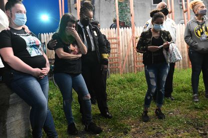 BPD col. Sheree Briscoe, center, consoles Michelle Torres, mother of Marcus Wilson during vigil. On right is Flormotenjo Mendez, sister of Fabian Mendez. Both men were killed recently. April 5, 2021