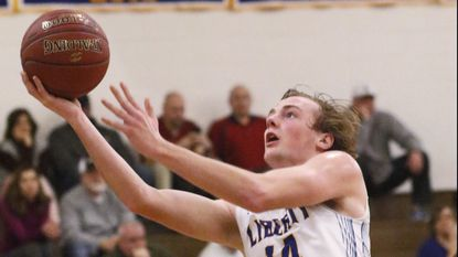 Liberty's Peyton Scheufele against Westminster in Carroll County Athletic League boys basketball action in Eldersburg