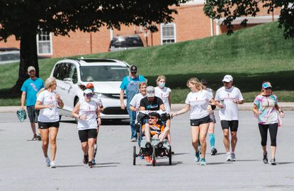New Windsor resident Francis Moats completed the final two-tenths of a mile of a marathon Sunday, Aug. 23 in Winfield. Moats planned on competing in the Marine Corps Marathon this year before diagnosed with terminal brain cancer in May, so his friends and family brought the race to him.