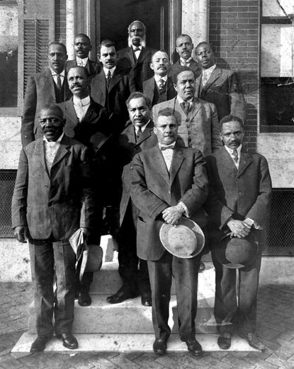 This image depicts the ad hoc committee of attorneys and ministers who fought successfully to place African-American teachers into Baltimore's Colored High School at the turn of the century. Many in this group went on to assume a leadership role in early civil rights struggles. W. Ashbie Hawkins (Second row,center) mounted a vigorous challenge to city residential segregation ordinances; Baltimore's NAACP was founded in his living room. Warner T. McQuinn (3rd row,second from rt) , later elected a city councilman, became a leader in Baltimore's NAACP. The first African- American in Maryland to be elected to high political office, Harry Sythe Cummings (1866-1917) served several terms as a Baltimore City council member. Elected in 1890 on the Republican ticket, the Baltimore attorney soon garnered the notice of national political party leaders. Councilman Cummings, one of Maryland's early civil rights leaders, lobbied for greater education and training opportunities for black citizens at a time of increasing racial segregation in our national history. -- Reproduction of albumen print, c. 1900. Prints and photos, Library Division, MD Historical Society. (Handout scanned 11/30/99)