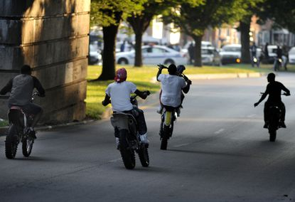 Dirt bikers are pictured on Gwynns Falls Parkway.