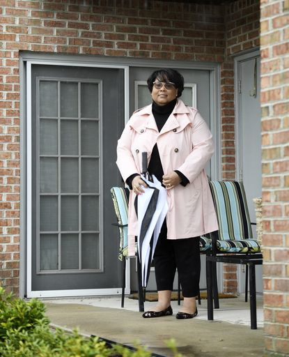 Alecia Gaither cares for her mother, who is on dialysis, at her Eldersburg home.