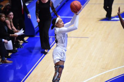 Aryna Taylor of Mount St. Mary's shoots during a game this season. Taylor wears a knee brace after having three separate surgeries for leg injuries.