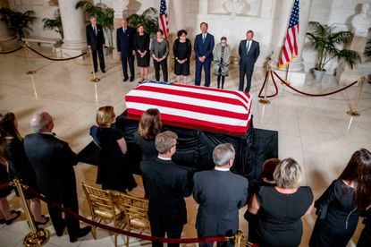 WASHINGTON, DC - JULY 22: From center left, retired Associate Justice Anthony Kennedy, Ashley Kavanaugh, the wife of Associate Justice Brett Kavanaugh, Associate Justice Elena Kagan, Associate Justice Sonia Sotomayor, Associate Justice Samuel Alito, Associate Justice Ruth Bader Ginsburg, and Chief Justice John Roberts participate in a ceremony along with family, below, for the late Supreme Court Justice John Paul Stevens as he lies in repose in the Great Hall of the Supreme Courton July 22, 2019 in Washington, DC. Justice Stevens died at the age of 99 and will be buried at Arlington National Cemetery. (Photo by Andrew Harnik- Pool/Getty Images)