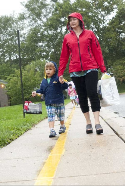 AT LAST, BACK TO SCHOOL: Isabella Kartuz walks her son, Alex Kartuz, to Riderwood Elementary School for his first day of kindergarten on Sept. 5. Riderwood was one of many area schools that did not open last week due to power outages caused by Hurricane Irene. On Tuesday, the school system experienced its first day with all schools open for business.