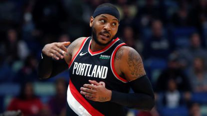 Portland Trail Blazers forward Carmelo Anthony turns down court after making a 3-pointer against the New Orleans Pelicans in New Orleans, Tuesday, Nov. 19, 2019.