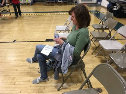 Megan Ossing waits for her turn to donate blood at an American Red Cross blood drive at Catonsville Middle School on Oct. 17.