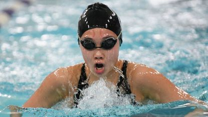 C. Milton Wright freshman Hannah Chan, shown in Harford County swimming championship action, won two region titles Saturday.