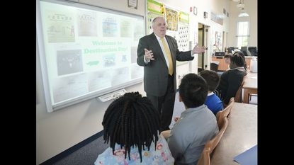 Governor Larry Hogan speaks with the students in the media center. Governor Larry Hogan spoke to the third and fourth grade classes at the Annapolis Elementary School as part of the schools Destination Day, their version of career day.
