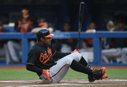 Orioles center fielderAdam Jones falls after fouling a ball off umpire CB Bucknor in the first inning against the Toronto Blue Jays on June 19, 2015 at Rogers Centre in Toronto.