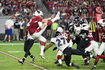 Arizona Cardinals punter Drew Butler's kick is blocked by Ravens cornerback Asa Jackson in the fourth quarter. The play led to a touchdown for the Ravens.