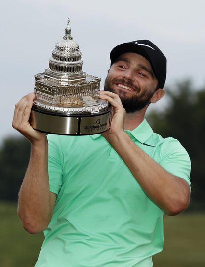Kyle Stanley holds the trophy after winning the Quicken Loans National on Sunday in Potomac. Stanley won in a playoff.